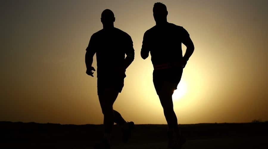 men jogging in the sunset during their morning routine